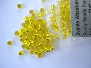 Debbie Abrahams Silver Lined Yellow Beads Size 6/0